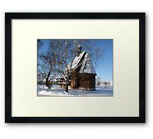 Wooden church in winter Framed Print