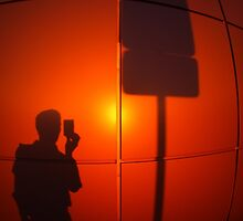The silhouette of a man on a red-orange wall by vladromensky