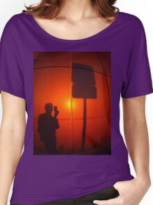 The silhouette of a man on a red-orange wall Women's Relaxed Fit T-Shirt
