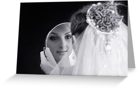Beautiful young bride looking in the mirror by ArtNudePhotos