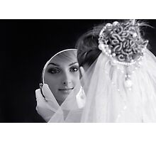 Beautiful young bride looking in the mirror Photographic Print