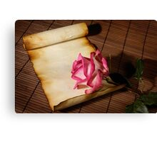Pink rose and a parchment Canvas Print