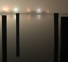 Dock Pylons in the Foggy Night - Clear Lake, Houston, Texas by Stephen J. Alexander