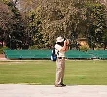 A tourist using a high powered camera inside the Red Fort in New Delhi, India by ashishagarwal74