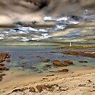 Lighthouse set against a surreal sky by Richard Majlinder