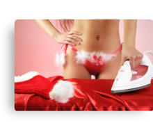 Sexy young woman getting ready for Christmas Canvas Print