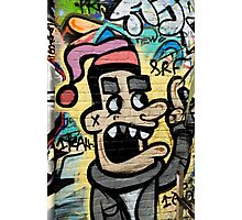 Graffiti man on the textured brick wall Photographic Print