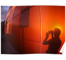 The shadow of a man on a red-orange wall, who photographs a road sign Poster