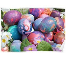 Easter eggs in a basket with primroses Poster