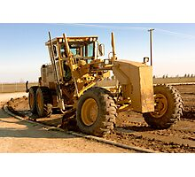 Yellow Grader Leveling at a Construction Site Photographic Print