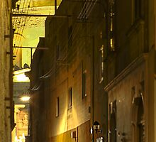 Mosta alley at nighttime in Christmastide by M G  Pettett