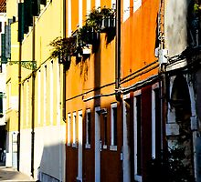 Sunlit colored buildings by Jaime Pharr