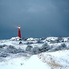 Lighthouse in the snow by Peter Voerman