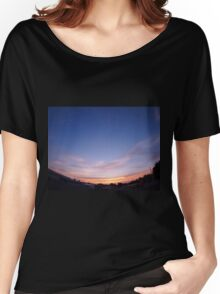 Skies with clouds over the city after sunset Women's Relaxed Fit T-Shirt