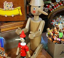 """""""Keep Going..."""" Pinocchios at a Toy Stand at a Street Market in Milano, Italy 2010 by Igor Pozdnyakov"""