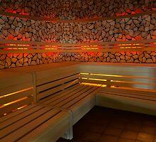 Finnish wooden sauna interior by Brünø Beach .