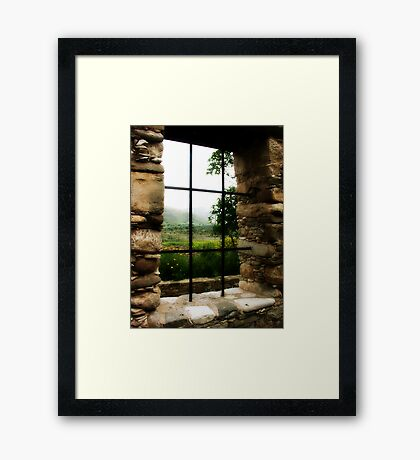 Window with a view.. Framed Print