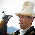 Kyrgyz eagle hunter with his bird by Speedy