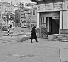 man walking to the station by fanis logothetis