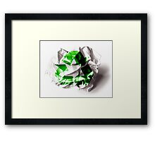 Recycle sign on torn paper background Framed Print