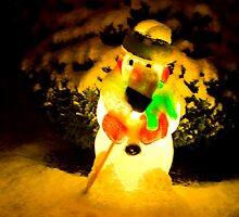 Frosty the Snowman at night in the snow by Michael Brewer