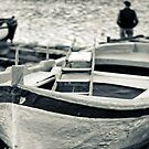 Old man and boat by Silvia Ganora