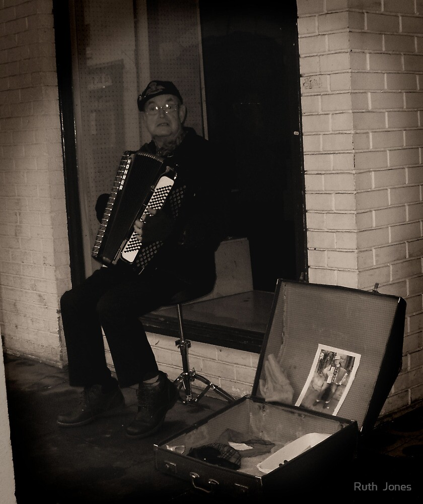 The busker and his accordian. by Ruth  Jones