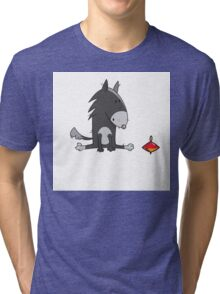 Wolf and spinning top. Tri-blend T-Shirt