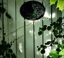 Old Garden Gate with Oval Iron Work and Leaves by M Sylvia Chaume
