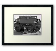 Young girl with poppy flower under rear of army tank Framed Print