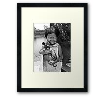 Girl with a puppy B&W Framed Print