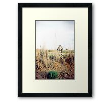 Soldier in the weeds Framed Print