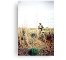 Soldier in the weeds Canvas Print