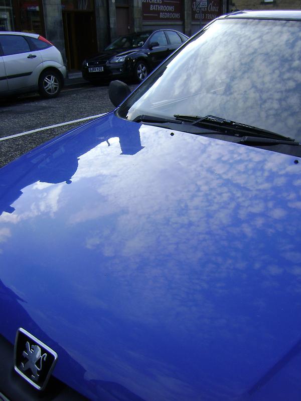 sky blue car by armadillozenith