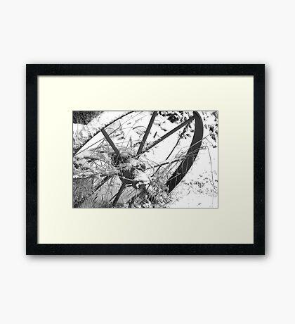Single plough wheel in the snow Framed Print