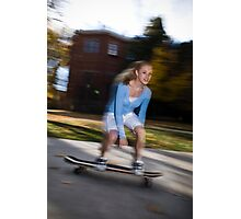 a teenage girl on a skateboard Photographic Print