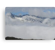 Peering through the clouds Canvas Print