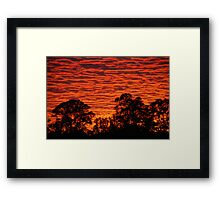Sun set over a city suburb Framed Print