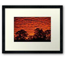 Sun set over a city suburb Framed Print