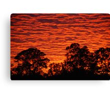 Sun set over a city suburb Canvas Print