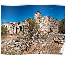 Old stone building on a dirt sideroad Poster