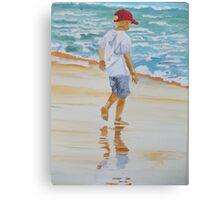 Boy on the beach red cap Canvas Print