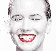 Artistic portrait of a smiling woman with water running over her face art photo print by ArtNudePhotos