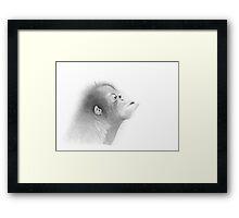 'A KISS' (infant female orang-utan) Framed Print