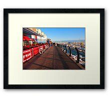 Walking along marina Framed Print
