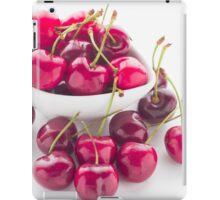 Bowl of fresh red cherries on white background iPad Case/Skin