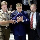 Deputy's Twin Brother at Funeral by Thomas Turney