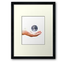 Earth in my hand Framed Print