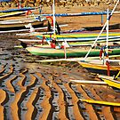 Fishing boats at low tide at dawn on Sanur Beach by Michael Brewer