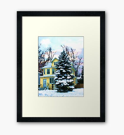 Yellow House in Snow Framed Print